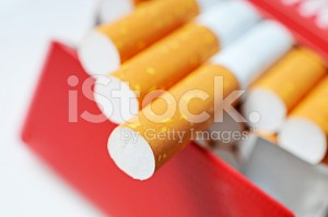 stock-photo-39960786-pack-of-cigarettes-in-red-box-with-filters-in-focus